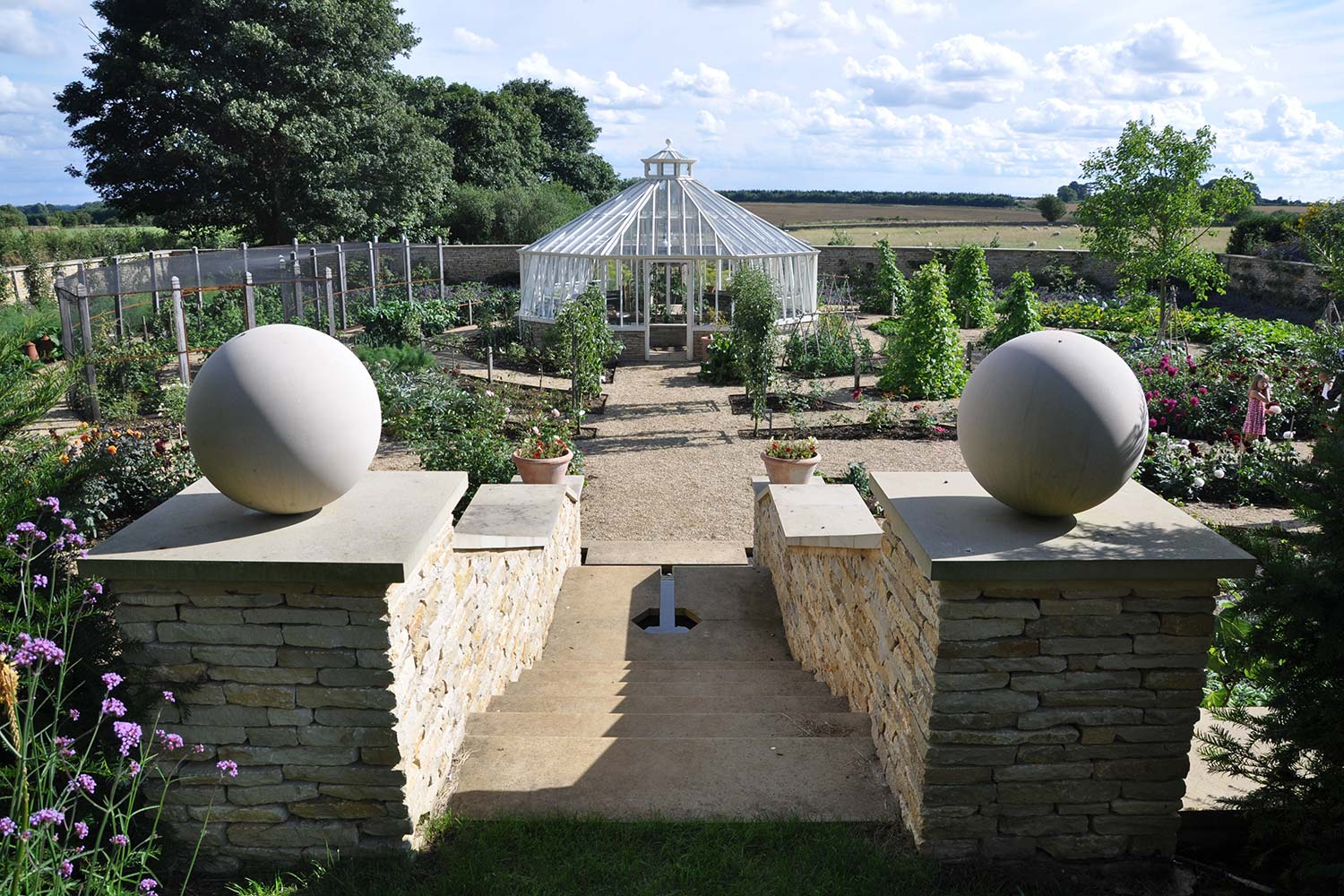 A distinctive freestanding hexagonal greenhouse in Off-white (Alitex)