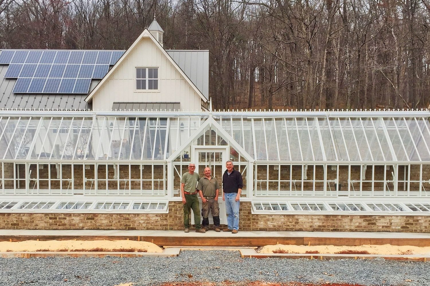 Greenhouse exterior with installers