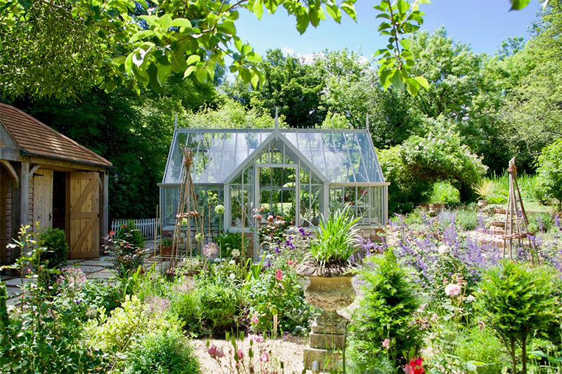 Victorian greenhouse with plants outside